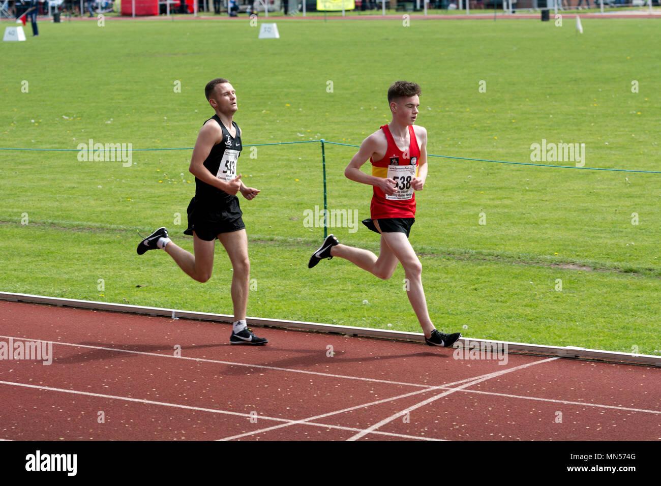 Runners in men`s 3000m race, Warwickshire County Championships, Nuneaton, UK - Stock Image