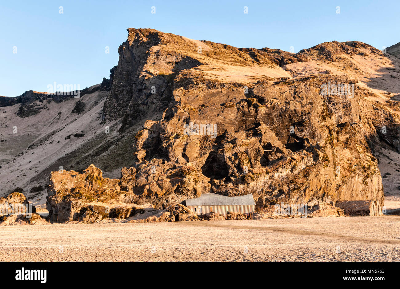 South Iceland. Drangurinn rock, in Drangshlíð below Eyjafjöll. In Icelandic legend it is the home of elves and was placed here by Grettir the Strong - Stock Image