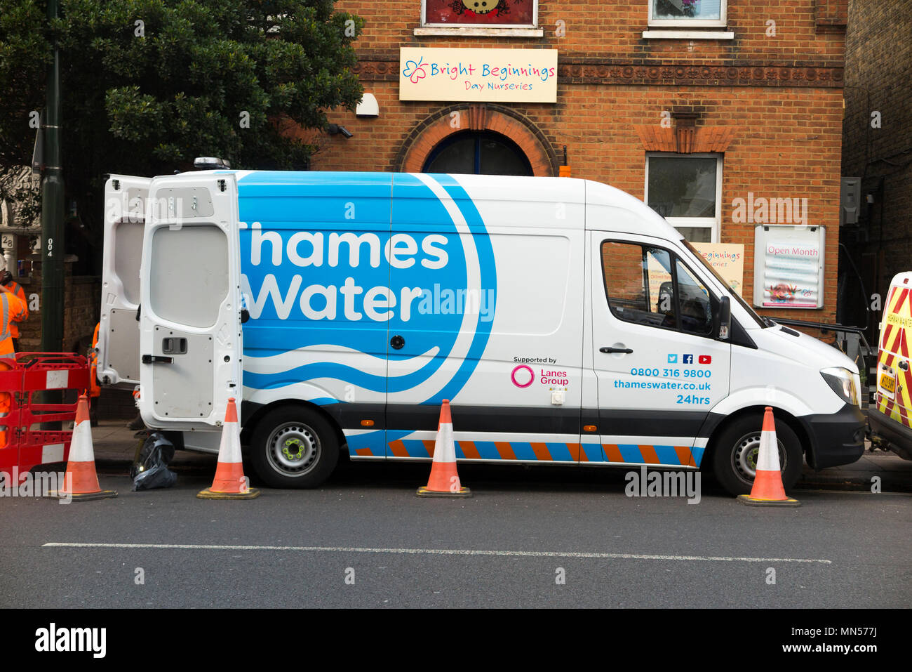 Thames water lorry / van / vans / vehicles at the site of a blocked pipe / drain / drainage / sewer blockage attended by their staff and workers in Twickenham, West London. UK (96) - Stock Image