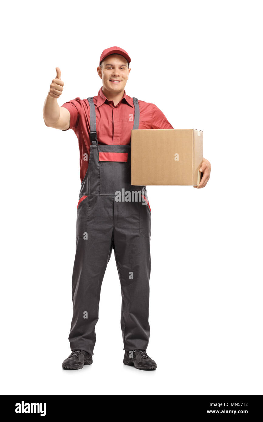 Full length portrait of a mover holding a package and making a thumb up sign isolated on white background - Stock Image