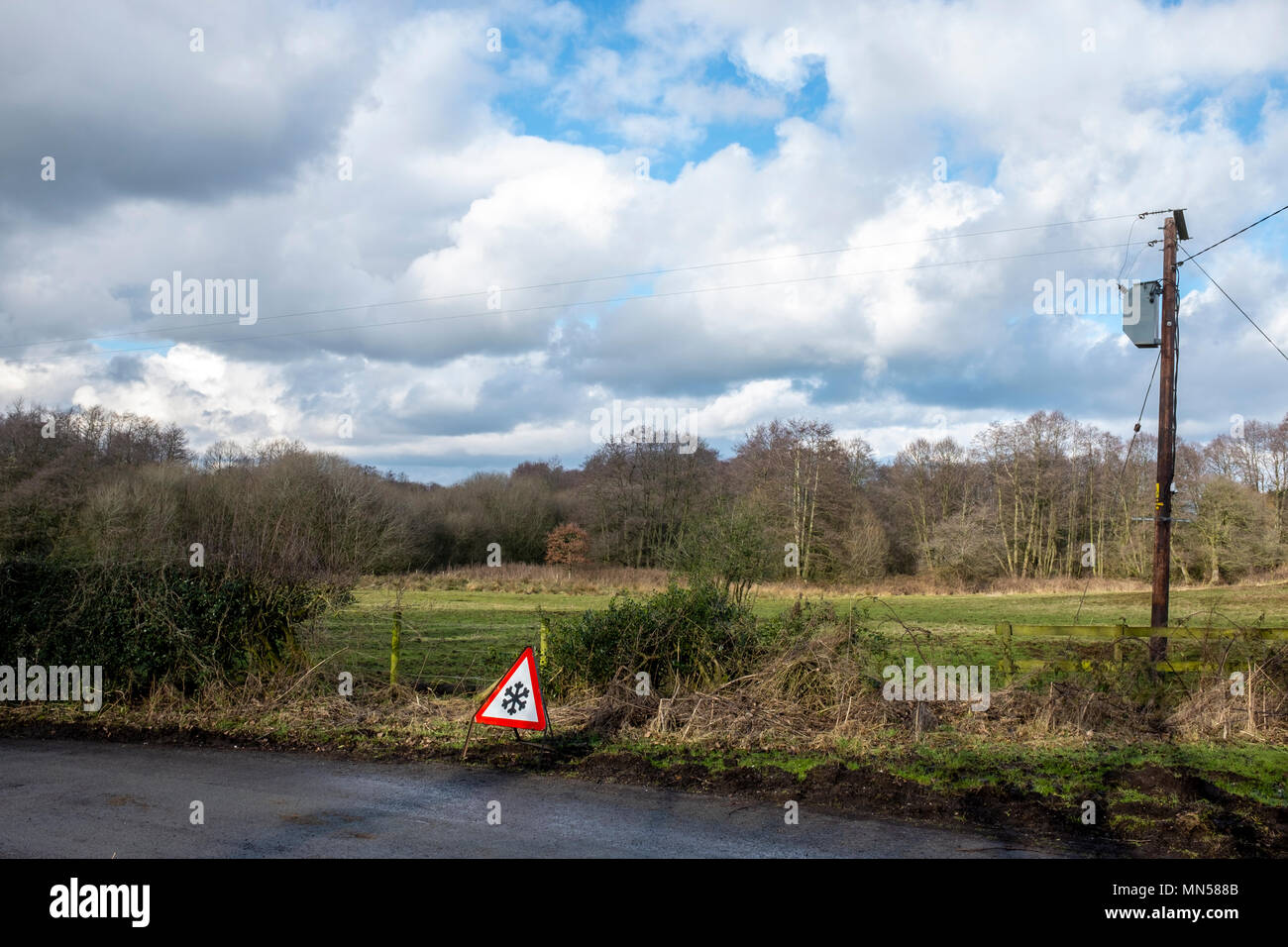 Ice on road warning sign in rural Cheshire UK - Stock Image