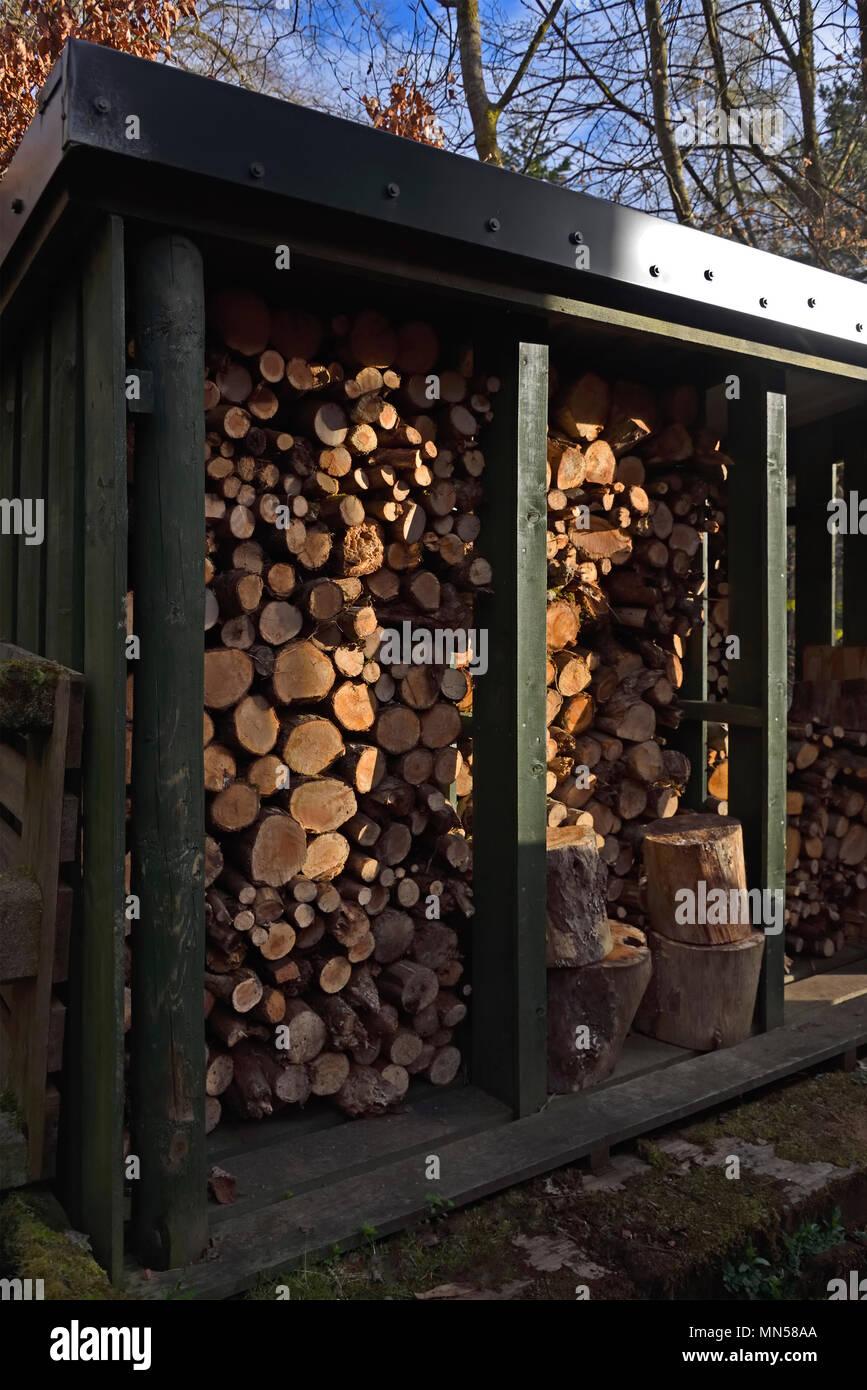 Detail of Outdoor Domestic Firewood Store. Bonnington, Lanarkshire, Scotland, United Kingdom, Europe. - Stock Image
