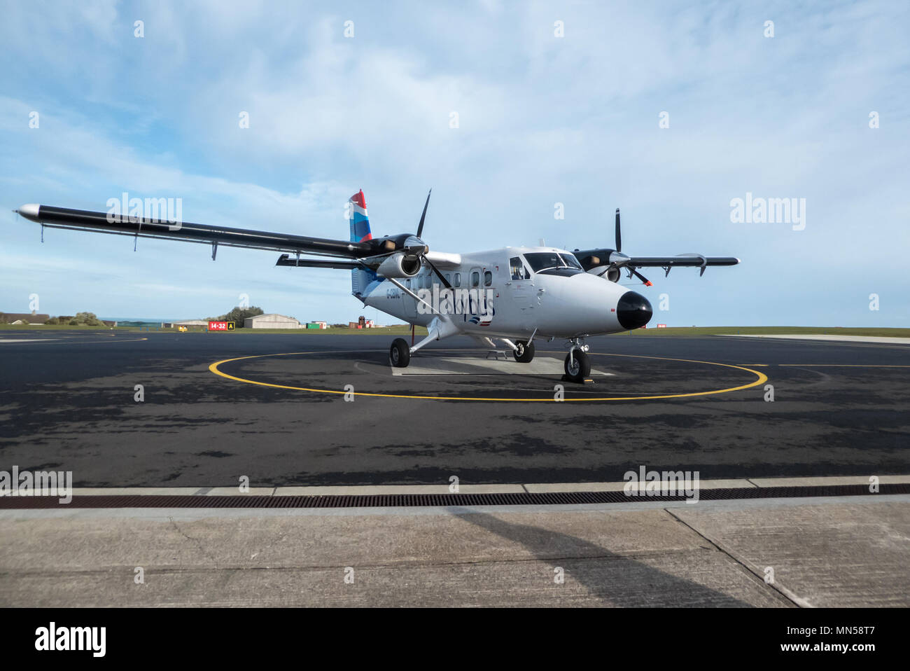 Skybus DHC-6 Twin Otter, on the tarmac at St. Mary's Airport, Isles of Scilly, UK - Stock Image