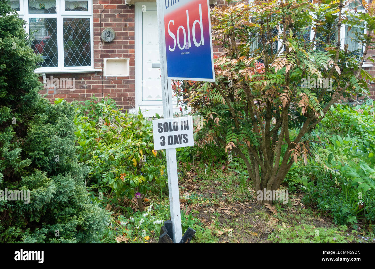 Sold in 3 days sign outside house. England, UK - Stock Image