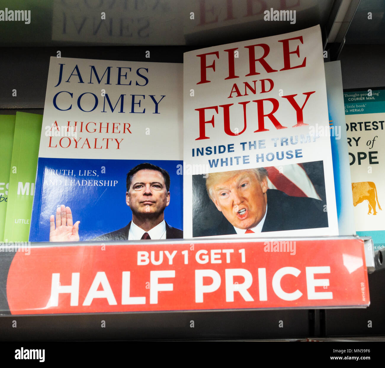 James Comey`s book (A higher Loyalty) and Michael Wolff`s book (Fire And Fury) side by side in bookstore - Stock Image