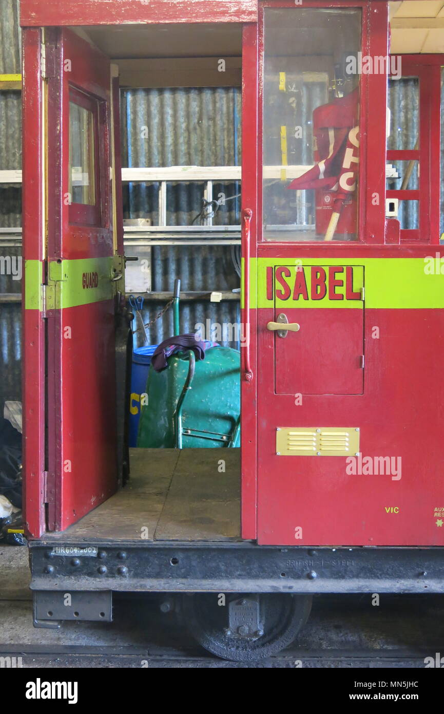 A red painted carriage named 'ISABEL' in the shed at the Leighton Buzzard narrowgauge railway - Stock Image