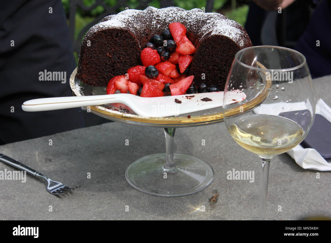 Chocolate bundt cake with strawberries served as a dessert. - Stock Image