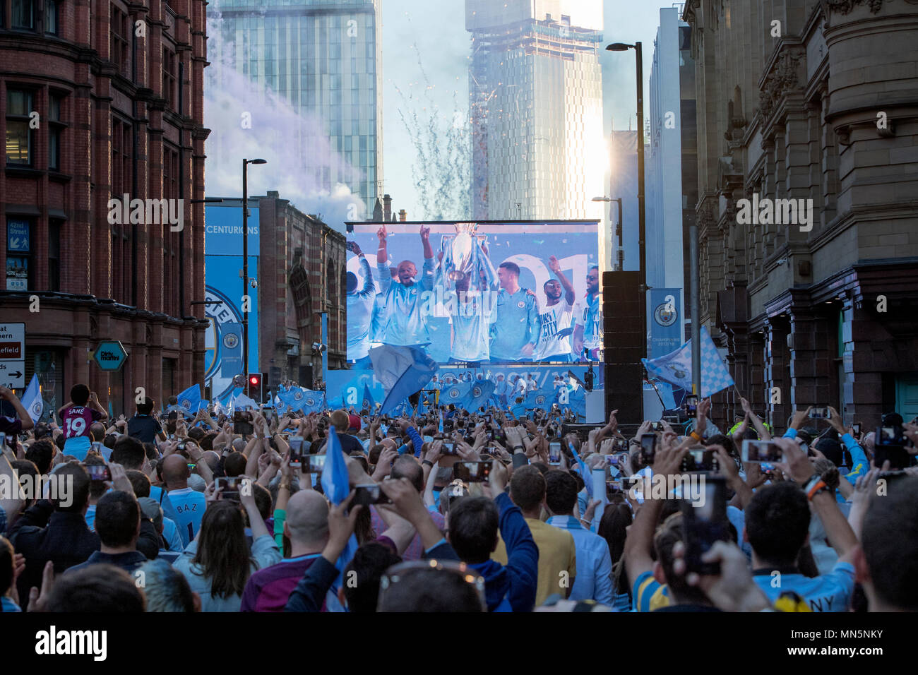 Manchester City players lift the trophies on stage during the ...