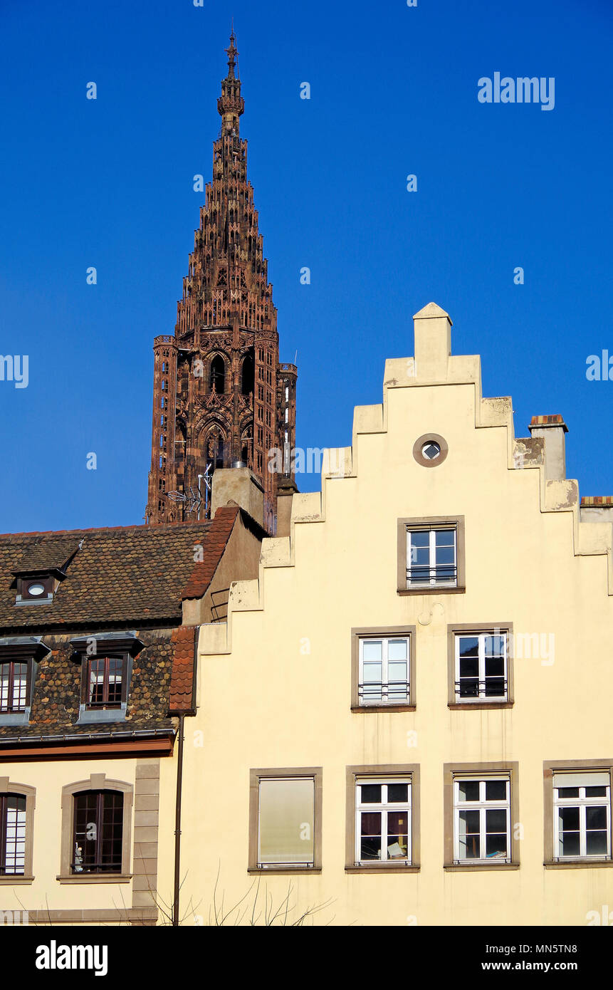 The High, or Late Gothic spire of  the Cathedral of Notre Dame de Strasbourg, seen from ground level in a neighbouring quarter. Stock Photo