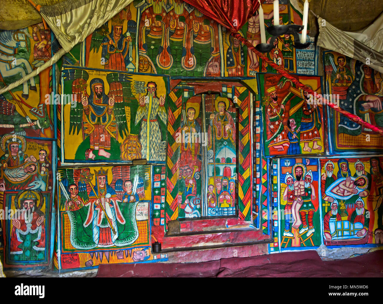 Canvas paintings with biblical motifs in the interieur of the orthodox rock-hewn church Mikael Mellehayzengi, Tsaeda Amba, Tigray, Ethiopia - Stock Image