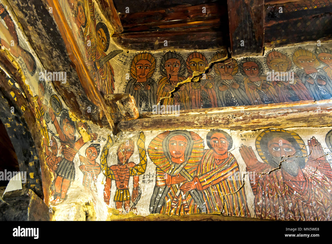 Biblical scenes: top: Elders of the Apocalypse, bottom: Mary and apostel John at the crucifixion, rock-hewn church Petros and Paulus, Tigray, Ethiopia - Stock Image