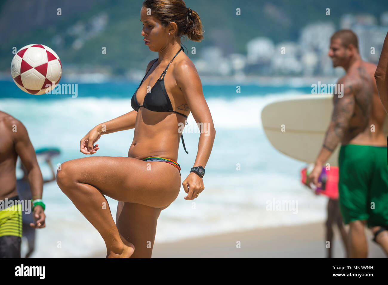 RIO DE JANEIRO - FEBRUARY 09, 2017: Young Brazilian woman a game of keepy-uppies (known locally as altinho) on Ipanema Beach. Stock Photo