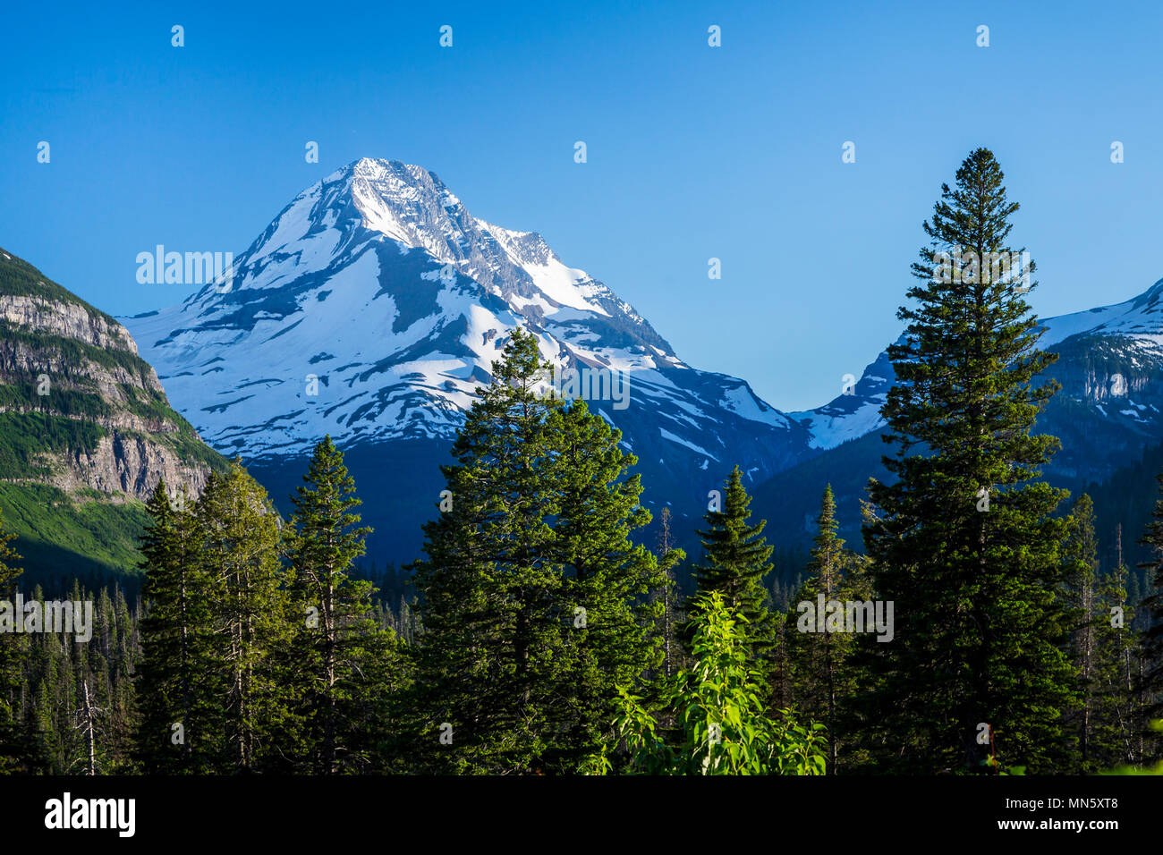 Alpine scenery with snow covered Mount Jackson near St. Mary Lake in Glacier National Park, Montana, USA. - Stock Image