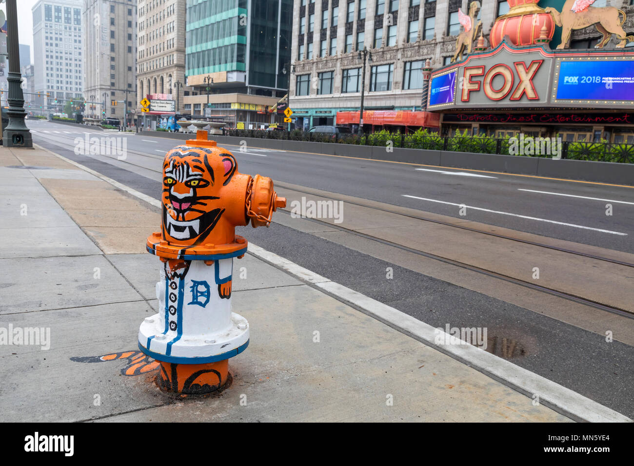 Detroit, Michigan - A fire hydrant painted in Detroit Tigers colors, near Comerica Park, home of the Detroit Tigers major league baseball team. - Stock Image