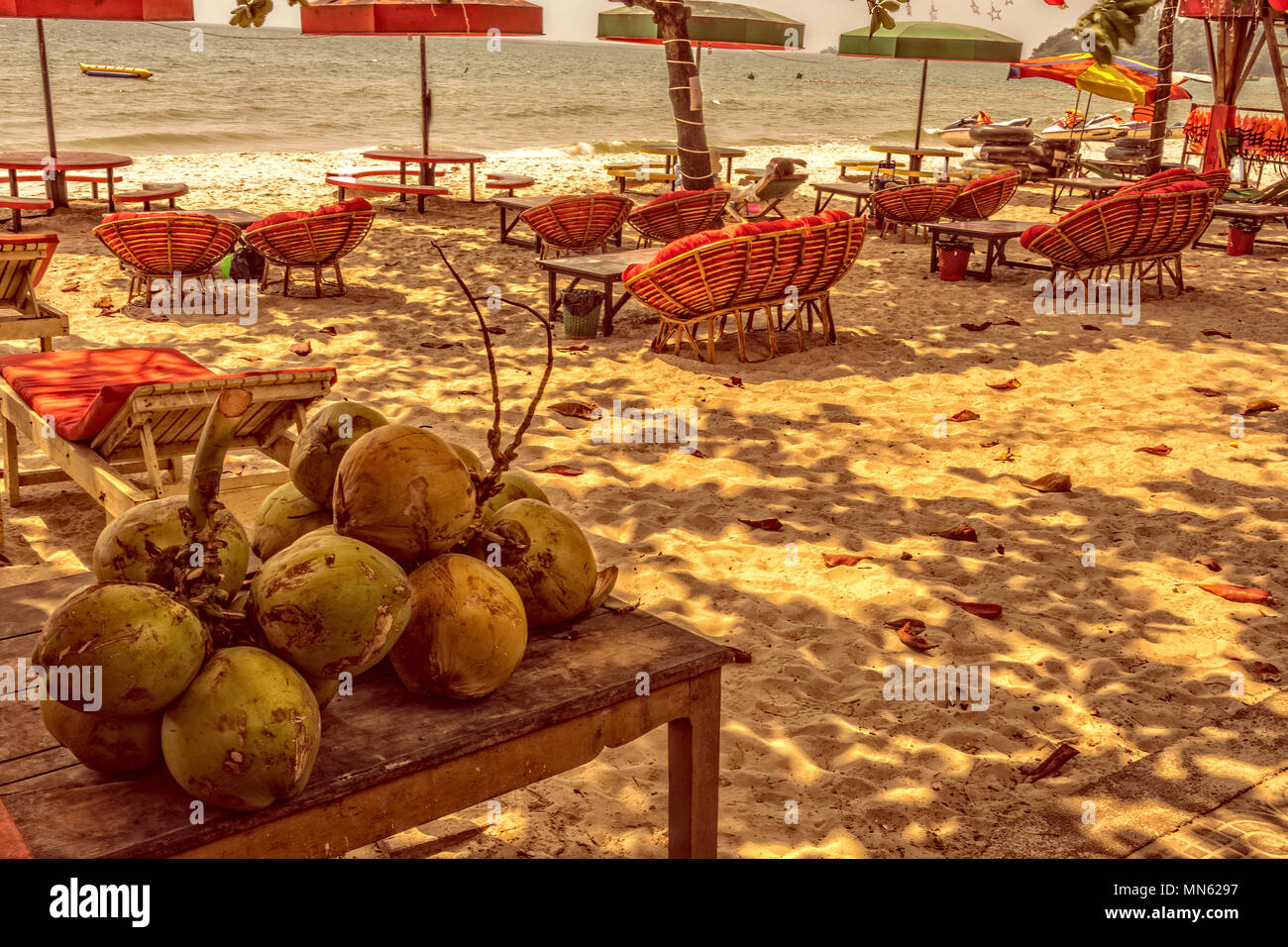 cocos sun sand and turquoise sea on the ochheuteal tourist beach near the city of Sihanoukville. Cambodia - Stock Image