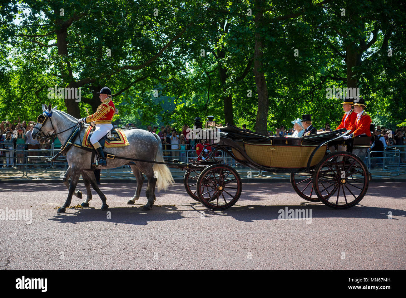 LONDON, UK - JUNE 17, 2017: Her Majesty Queen Elizabeth II and Duke of Edinburgh travel by horse drawn carriage during the Trooping the Colour parade. Stock Photo