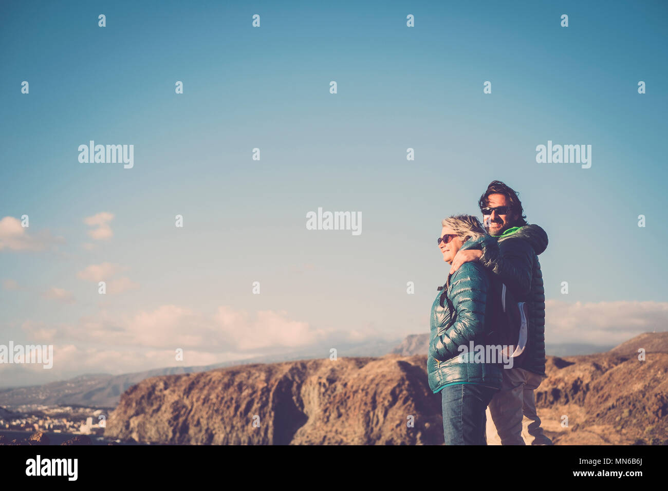 Mother with white hair and a 45 year old son spend time together smiling, surrounded by unspoiled nature. Between sea and mountain hiking and trekking - Stock Image