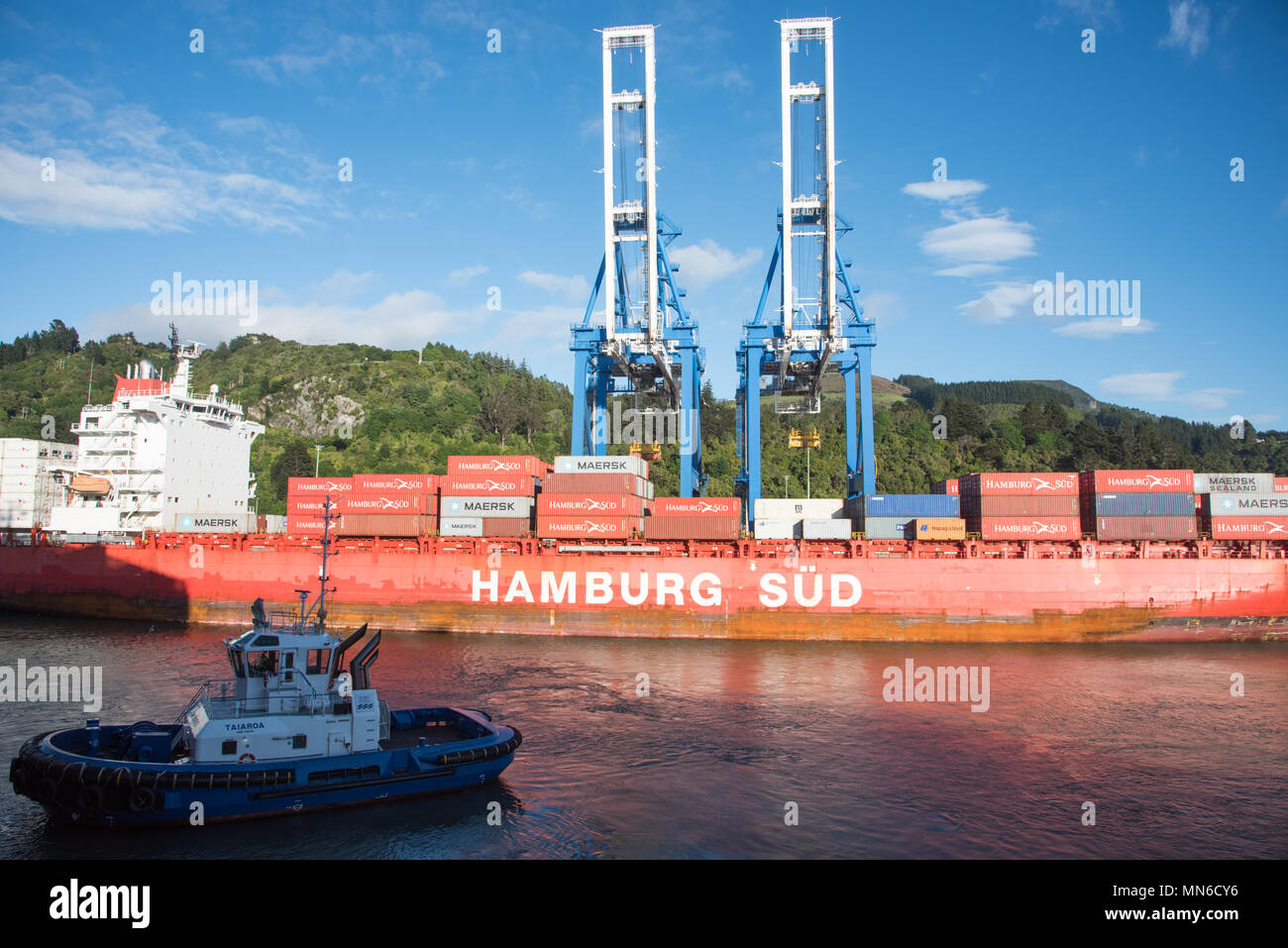 Dunedin, Otago, New Zealand-December 11,2016: Nautical vessel, cargo containers and gantry cranes at Port Chalmers in Dunedin, New Zealand - Stock Image