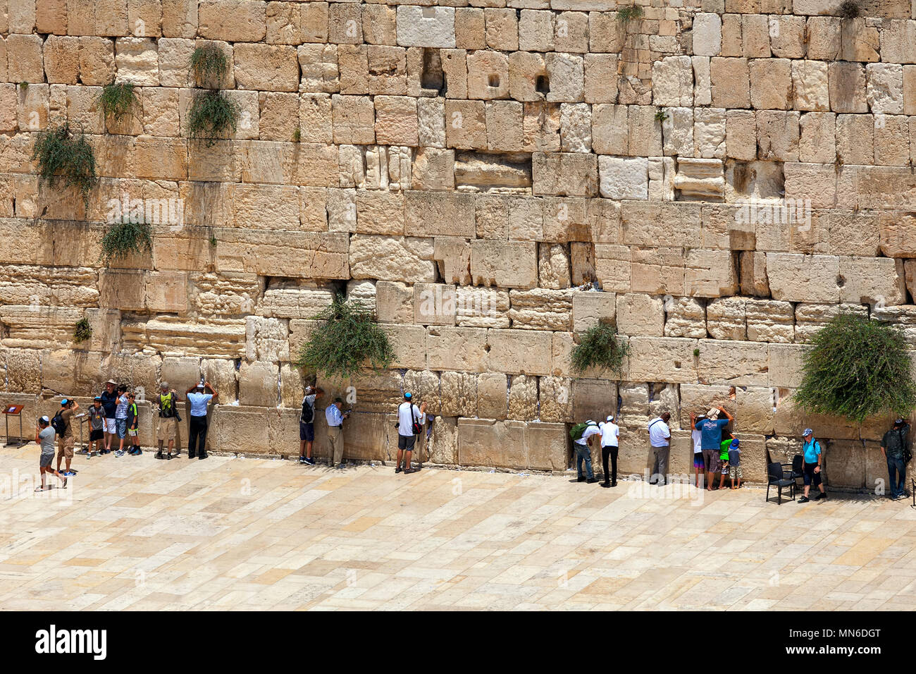 People praying at Western Wall - ancient wall in Old City of Jerusalem, Israel. - Stock Image