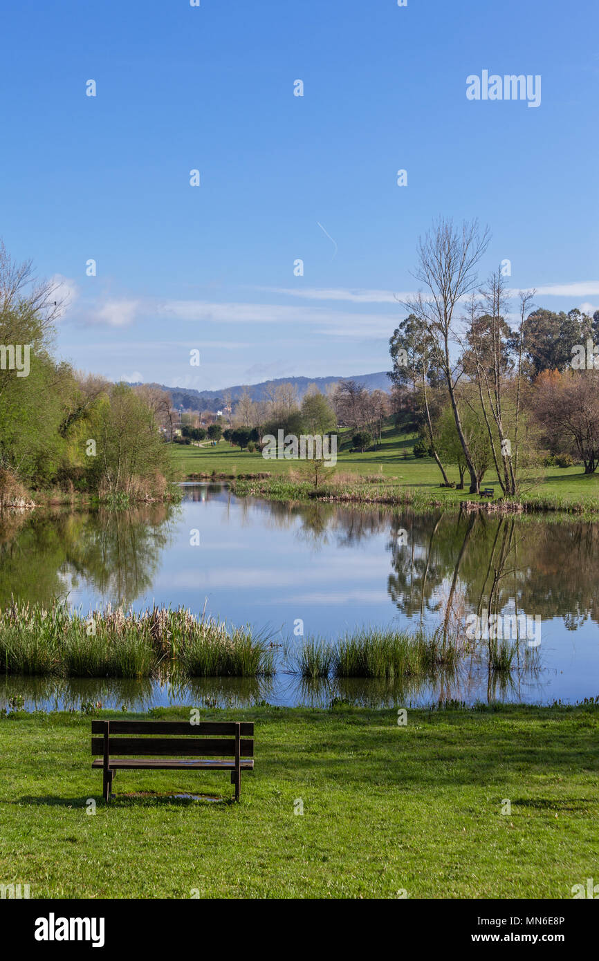 Strange Garden Bench Overlooking Lake Or Pond Of Parque Da Devesa Cjindustries Chair Design For Home Cjindustriesco