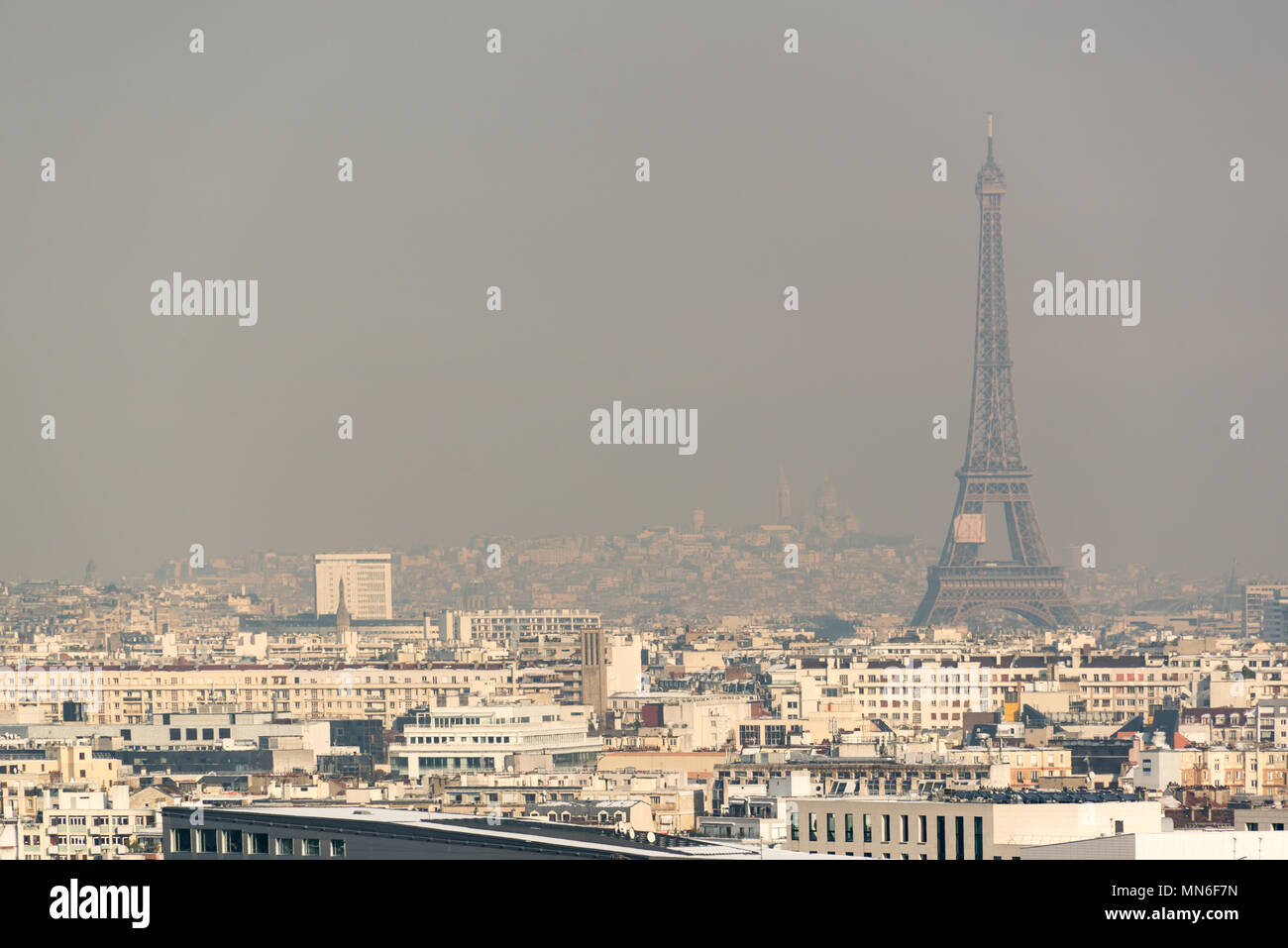 Aerial view of the Eiffel tower in the fog in Paris. City air pollution concept - Stock Image