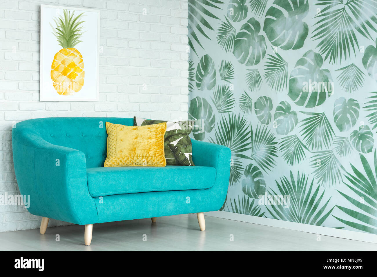 Awe Inspiring Yellow Pillow On Blue Sofa Against A Wall With Pineapple Evergreenethics Interior Chair Design Evergreenethicsorg