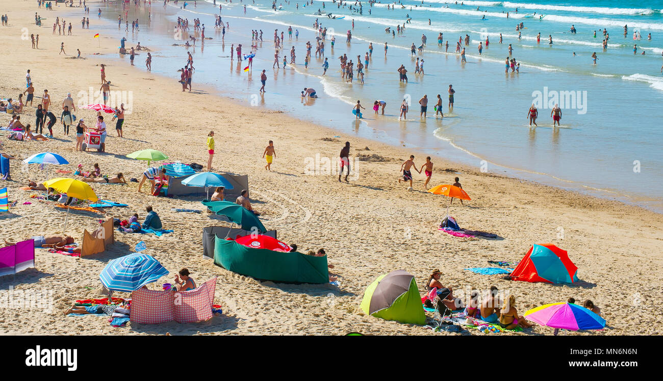 BALEAL, PORTUGAL - JUL 30, 2017: People at the ocean beach in a high peak season. Portugal famous tourist destination for it's ocean beaches. - Stock Image