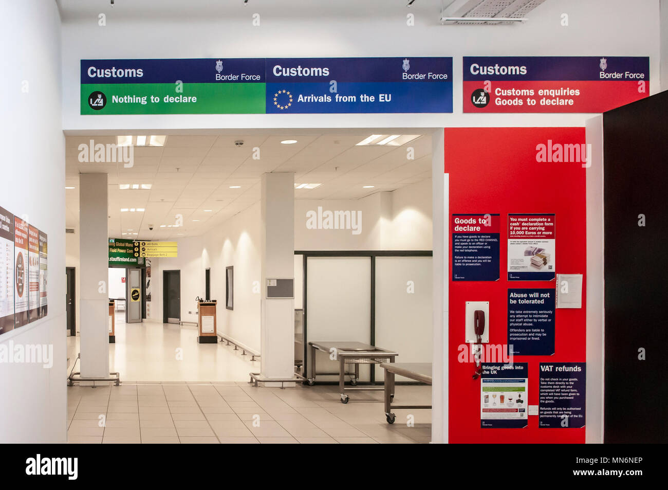 Green, blue and red customs channel at a UK airport. - Stock Image