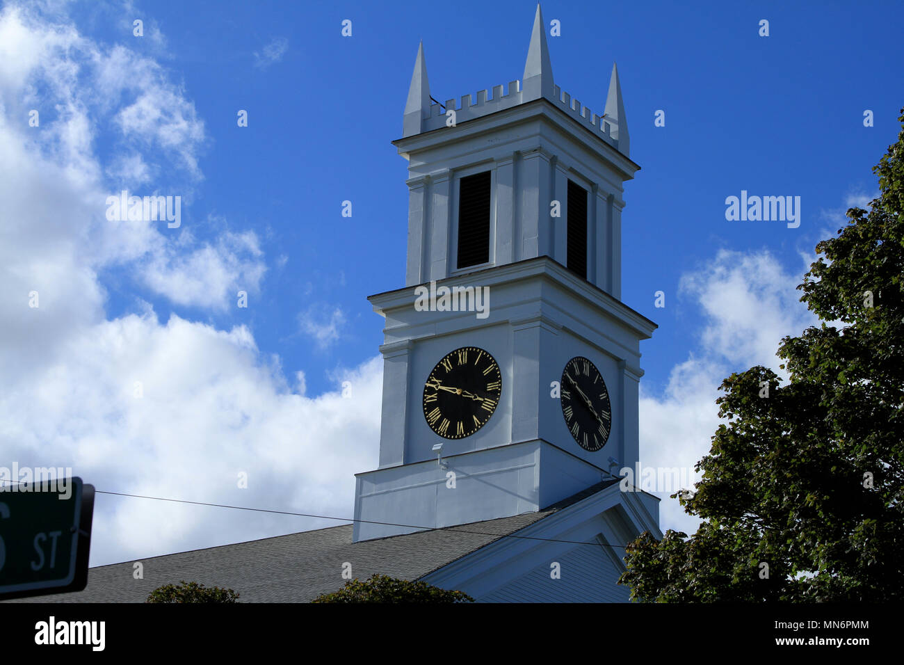 Steeple of the First United Methodist Church, Main Street, Chatham, Massachusetts, rising into a blue sky on an autumn day in New England Stock Photo