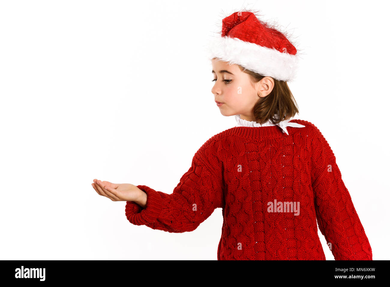 9a06271b4b97 Adorable little girl wearing santa hat isolated on white background. Winter  clothes for Christmas