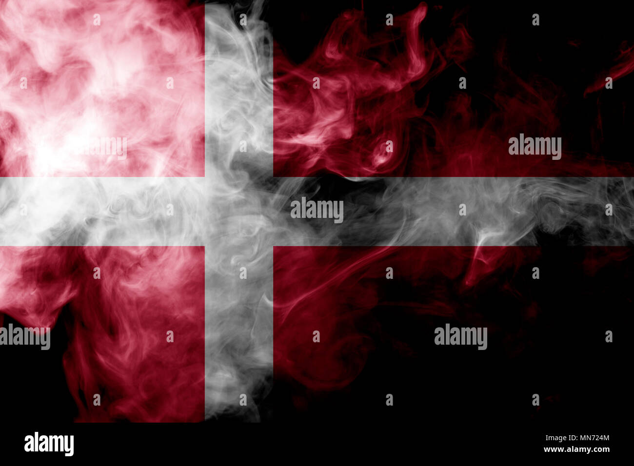 National flag of Denmark from thick colored smoke on a black isolated background - Stock Image