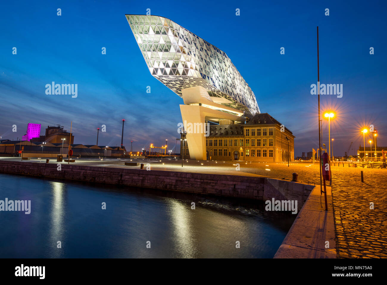 The Antwerp Port Authority building, in Antwerp, Belgium, former firemen's barracks in the harbor, renovated and fitted with a glass building, in the  - Stock Image