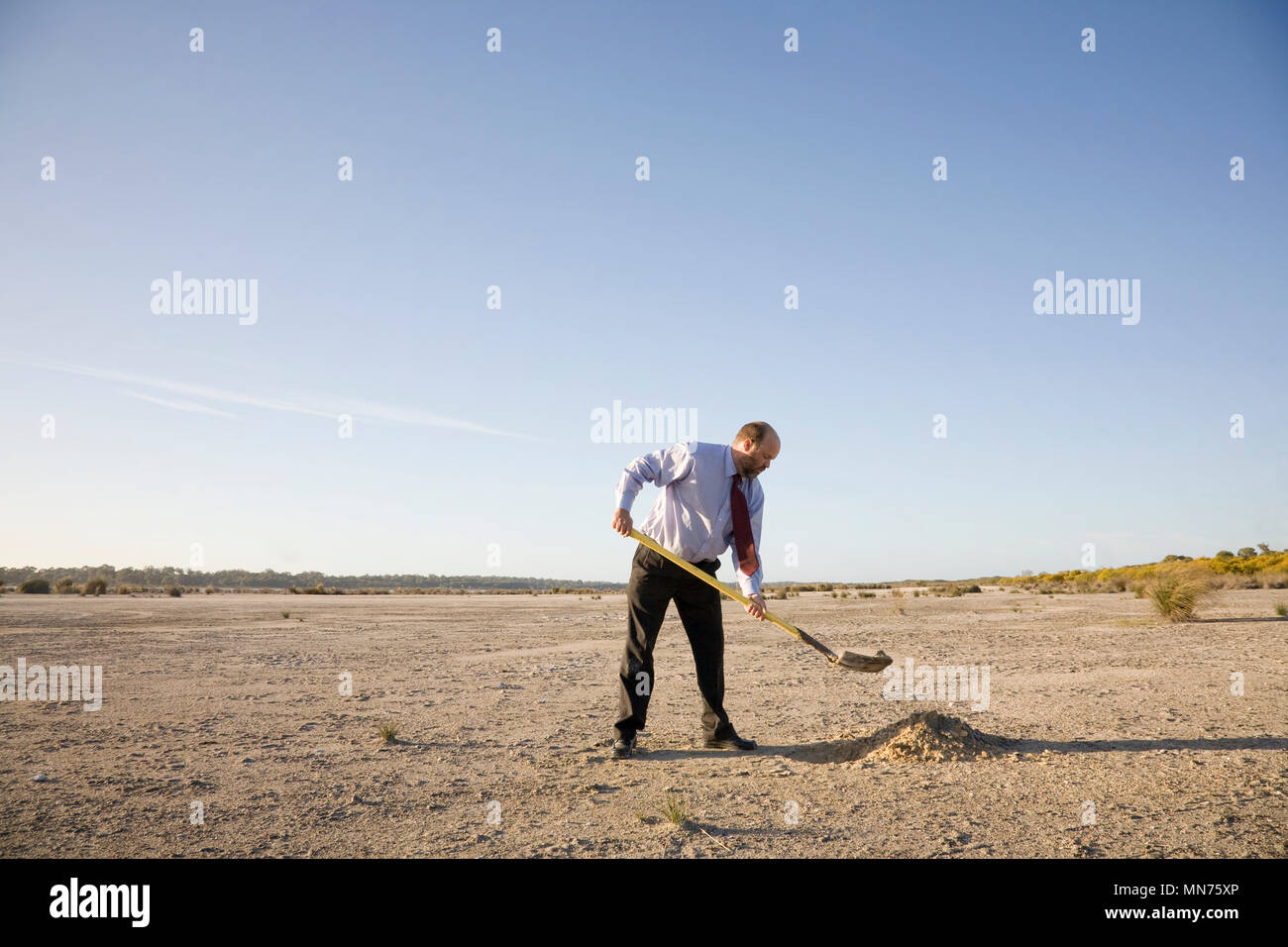 A business man digging a hole, business concepts. Stock Photo