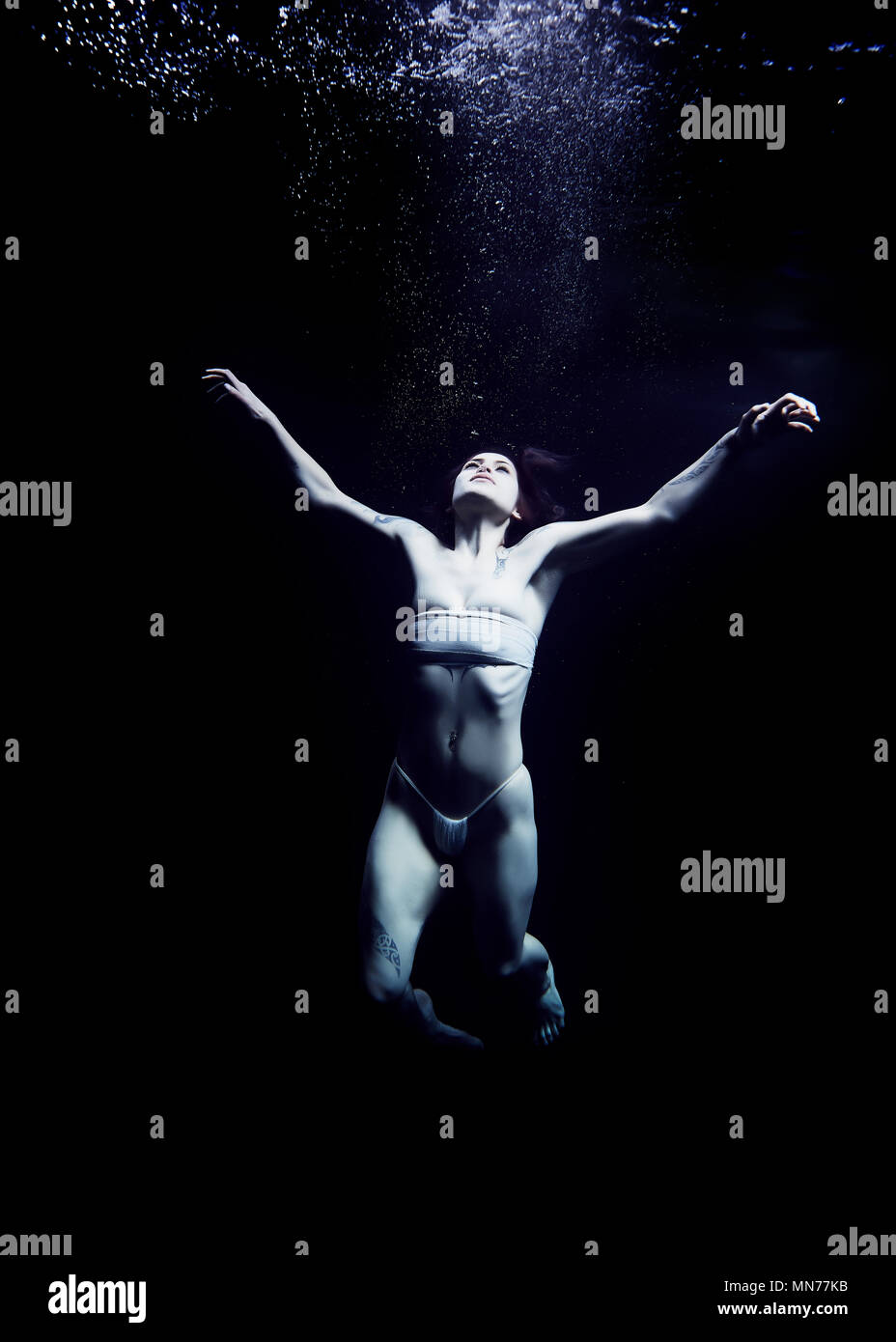 Submerged in an ocean of depression - Stock Image