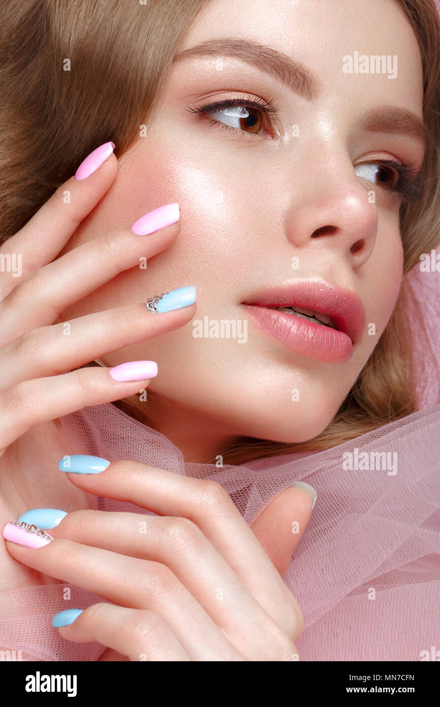 Beautiful girl with light make-up and gentle manicure in pink ...