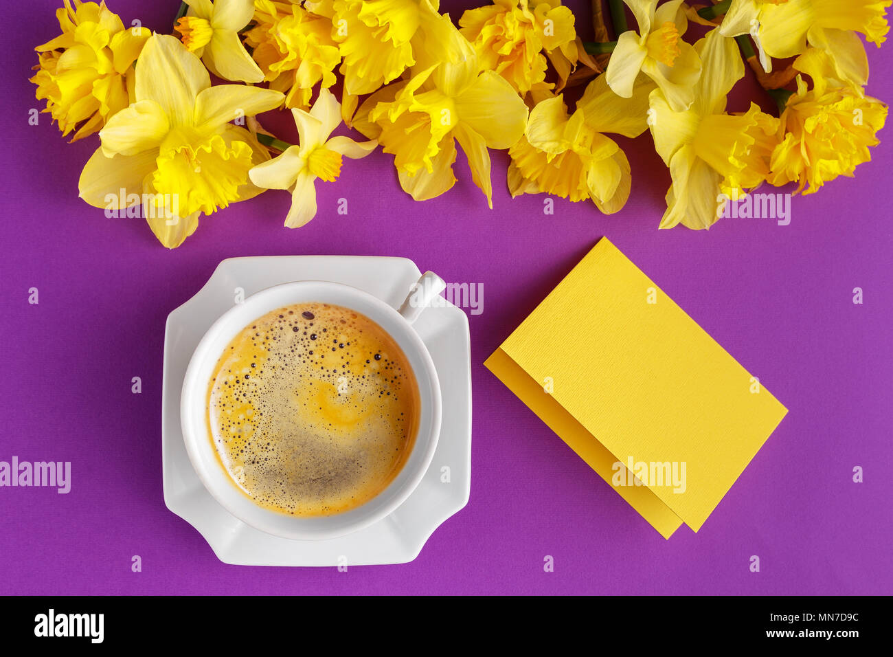 Cup Of Coffee Empty Message Card And Yellow Narcissus Flowers On