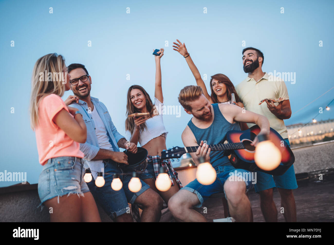 Friends having fun outdoors and are happy - Stock Image