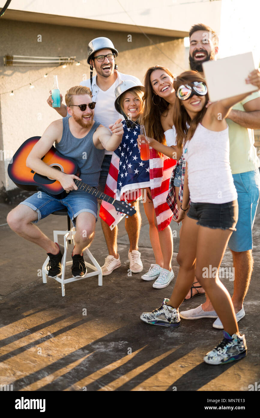 9027baa46b Friends Celebrating 4th Of July Holiday - Stock Image Friends Celebrating  4th Of July Holiday. MN7E13 (RF). Woman wears patriotic stars and stripes  bikini ...