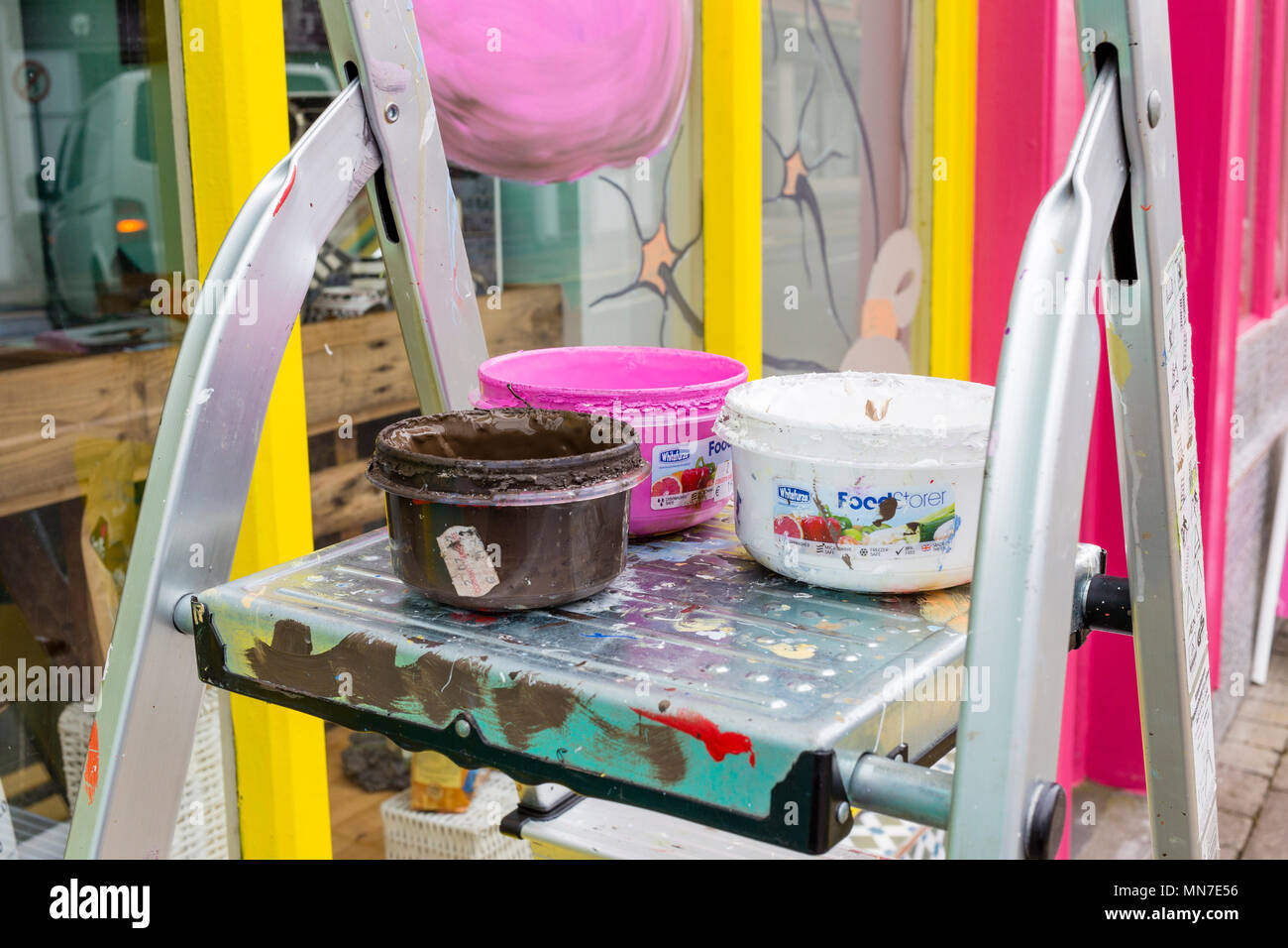 Window paints in pots on step ladder - Stock Image
