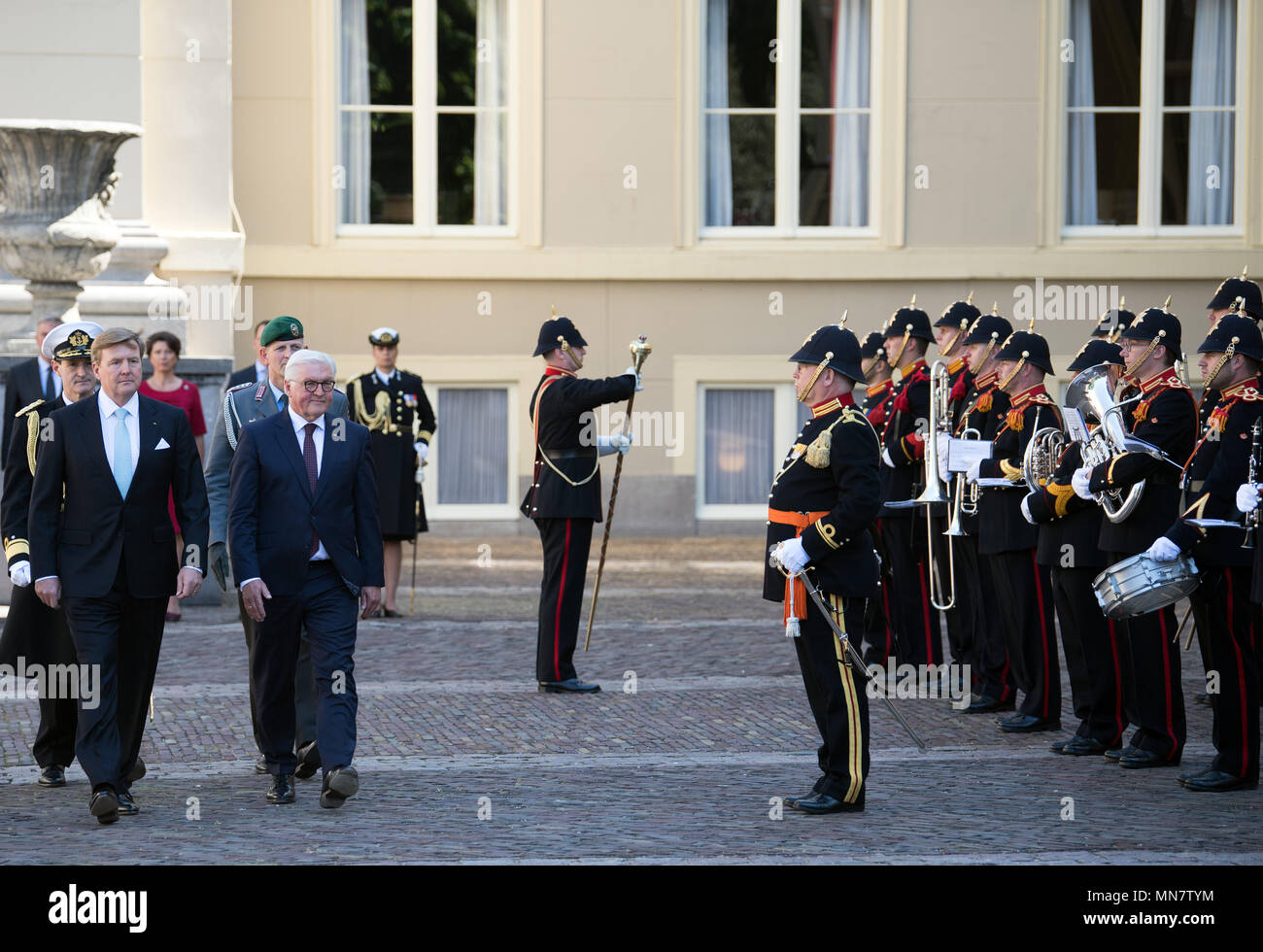 Amsterdam, The Netherlands. 15th May, 2018. German President Frank-Walter Steinmeier (C) is greeted with miliary honours by the King of the Netherlands, King Willem-Alexander (L), in the Palace Gardens. Photo: Soeren Stache/dpa Credit: dpa picture alliance/Alamy Live News Credit: dpa picture alliance/Alamy Live News Stock Photo