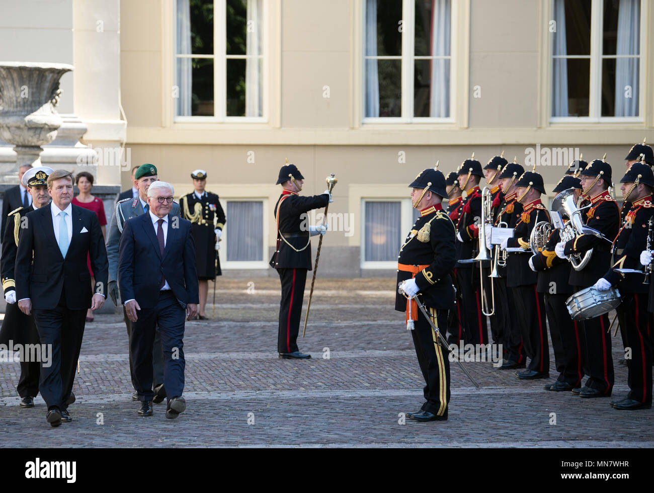 Amsterdam, The Netherlands. 15th May, 2018. German President Frank-Walter Steinmeier (C) is greeted with miliary honours by the King of the Netherlands, King Willem-Alexander (L), in the Palace Gardens. Photo: Soeren Stache/dpa Credit: dpa picture alliance/Alamy Live News Stock Photo