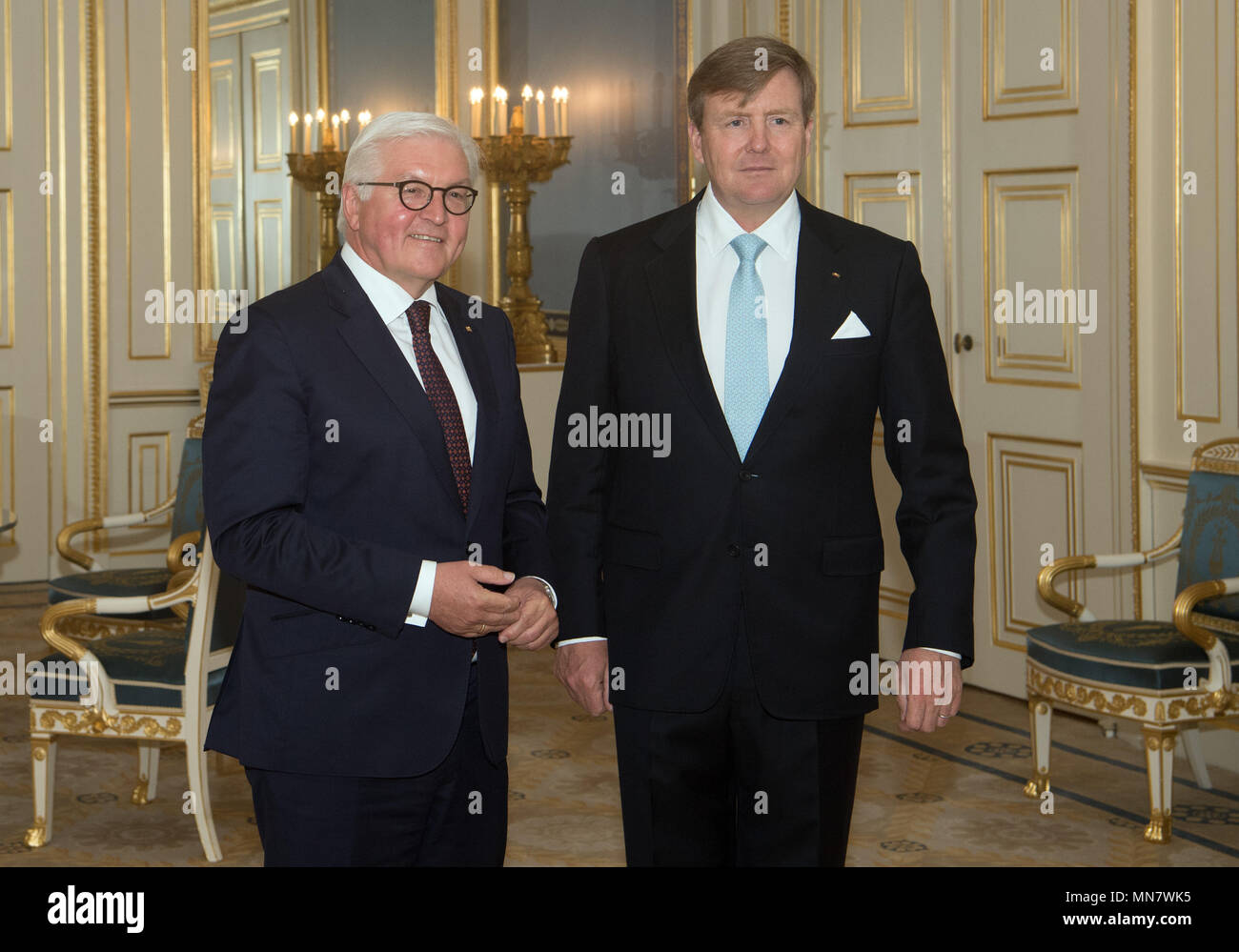 Amsterdam, The Netherlands. 15th May, 2018. German President Frank-Walter Steinmeier (L) is greeted by the King of the Netherlands, King Willem-Alexander, in the Palace. Photo: Soeren Stache/dpa Credit: dpa picture alliance/Alamy Live News Stock Photo