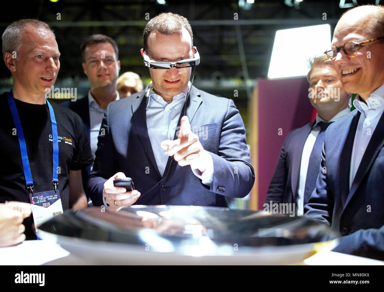 15 May 2018, Berlin, Germany: Jens Spahn of the Christian Democratic Union (CDU), Federal Health Minister, wears augmented reality glasses during a visit to the StartUp trade fair 'Cube Tech Fair'. Spahn participated in a discussion on 'Digitizing the Healthcare Industry through Blockchain and Artificial Intelligence.' Photo: Kay Nietfeld/dpa - Stock Image
