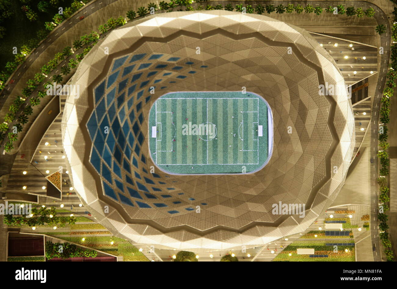 Doha, Qatar. 13th May, 2018. DOHA, QATAR - MAY 13, 2018: A mock-up of Ahmed bin Ali Stadium, a venue for 2022 FIFA World Cup football matches, seen at the Headquarters of the Qatar 2022 Local Organising Committee (LOC). Mikhail Aleksandrov/TASS Credit: ITAR-TASS News Agency/Alamy Live News Stock Photo