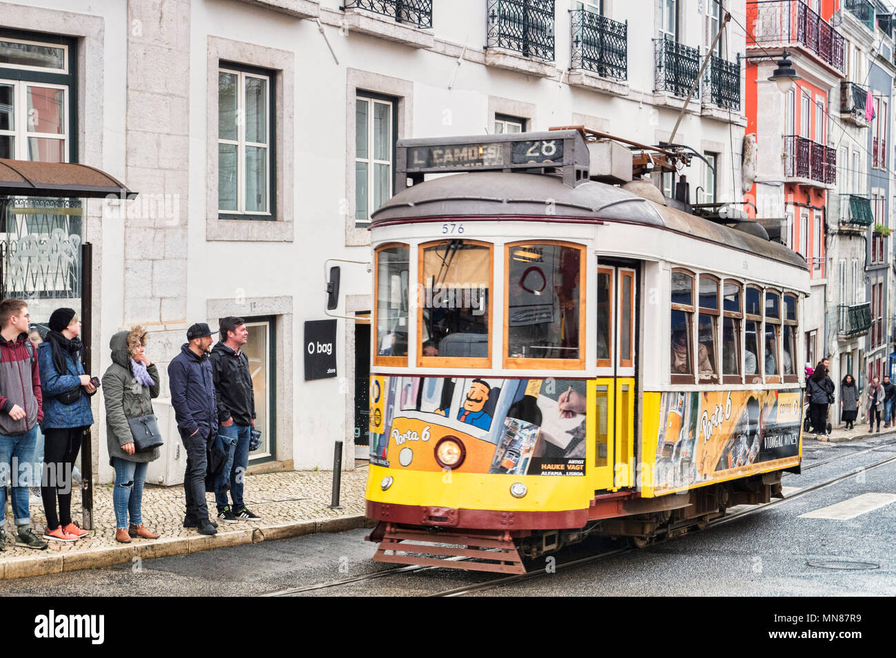 6 March 2018: Lisbon, Portugal - The famous 28 tram on its route in the central city. - Stock Image