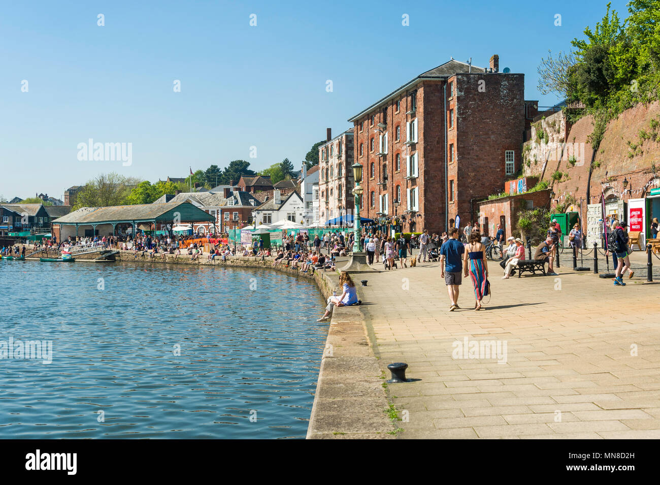 Locals and tourists strolling and shopping at Exeter Quay on a sunny Sunday afternoon, Exeter, UK. - Stock Image