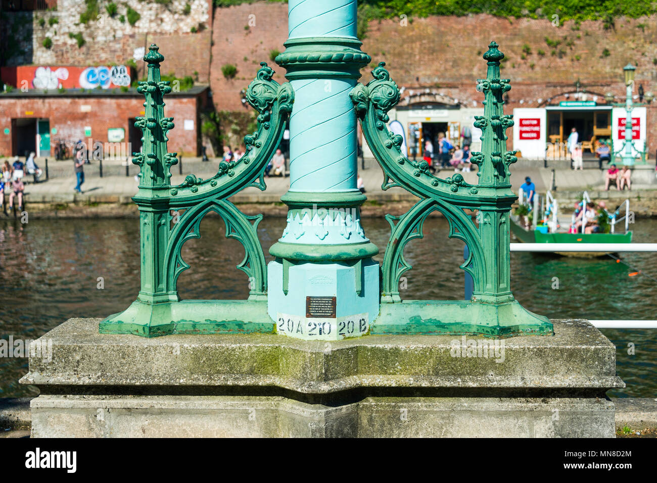 The base of an ornamental lamp standard that was preserved from the 1905 Exe Bridge.  It was cast by Macfarlanes of Glasgow. Stock Photo