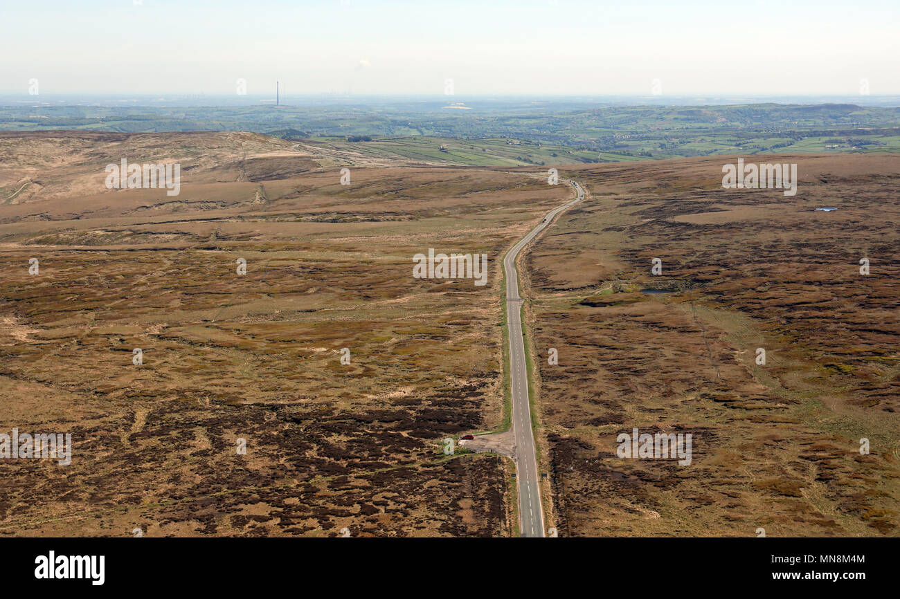 aerial view looking east towards Emley Moor TV mast from a moorland road on the Pennines near Oldham, UK - Stock Image