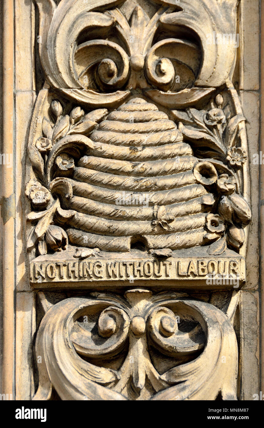 London, England, UK. Carved detail of beehive and 'Nothing Without Labour' on an external wall of Duchy House, 133 Strand - Stock Image