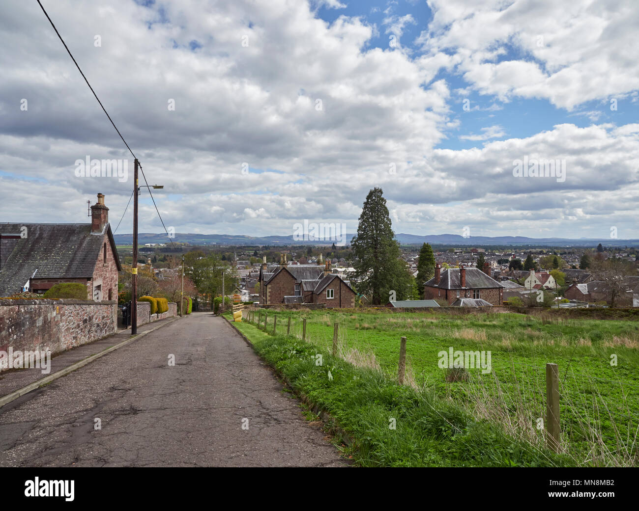Looking towards the Sidlaw Hills from Hill Street in Blairgowrie, with the Town in the Foreground with large Country Houses. Perthshire, Scotland - Stock Image